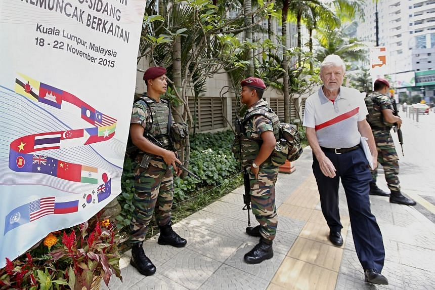 Malaysian soldiers standing guard outside the Kuala Lumpur Convention Centre, the venue of the 27th Asean Summit, on Nov 19.