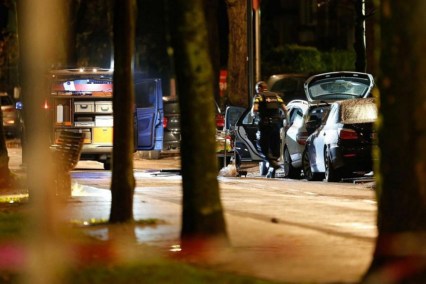 Police investigating a car with a Belgian number plate at the Westersingel in Rotterdam on Nov 20.