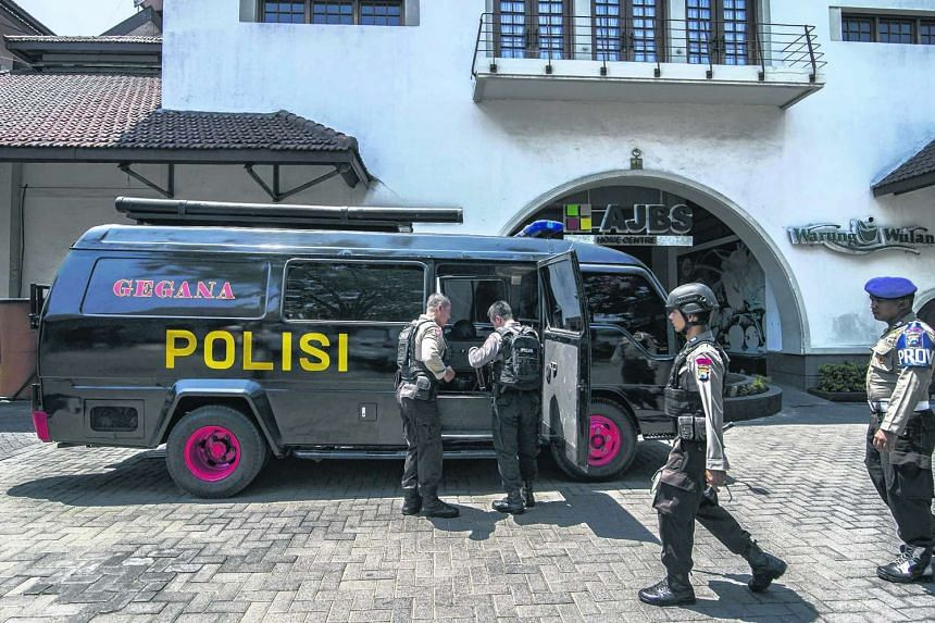 Indonesian anti-terror and bomb policemen check French Culture Institute (IFI Surabaya) as they heighten security at embassies and consulates across Indonesia.