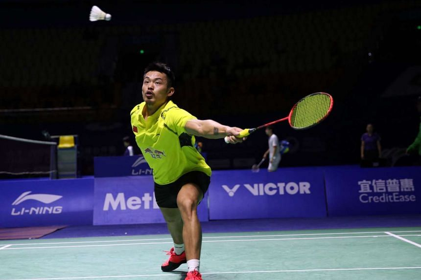 Lin Dan of China hits a return at the men's singles second round match at the China Open badminton tournament, Nov 12.