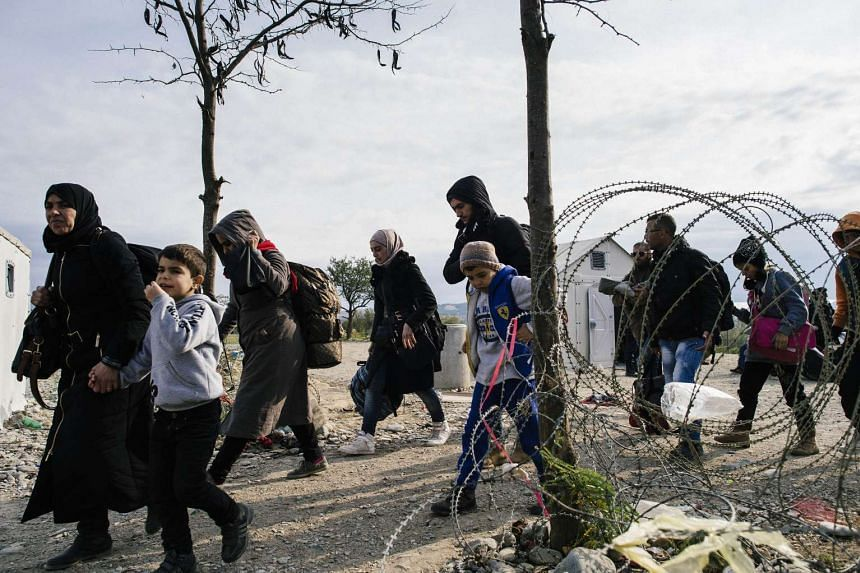 Migrants and refugees cross the Greek-Macedonian border near Gevgelija on Nov 15, 2015.