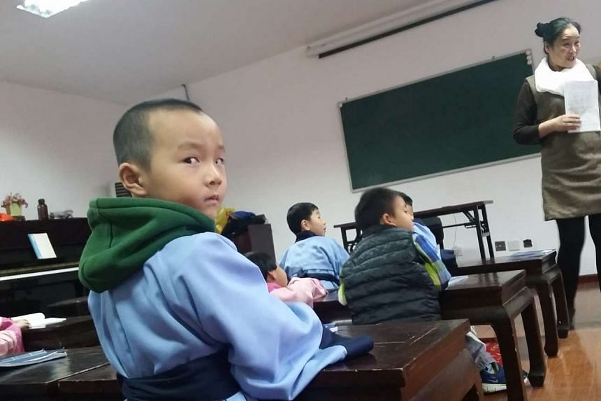 Pupils in class at the Chengxian Guoxue Institute, China.