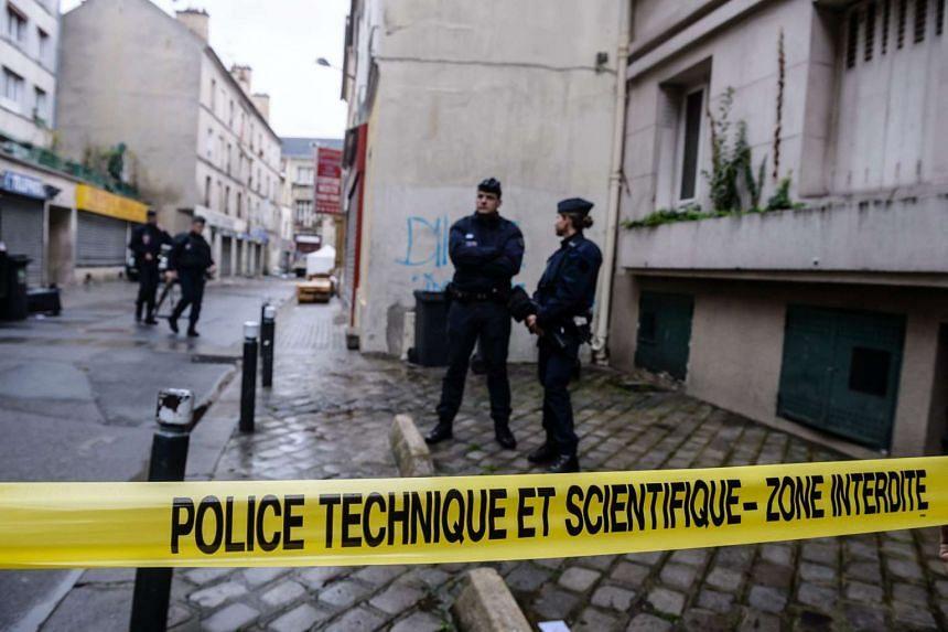 French police criminal scene investigators outside the rue du Corbillon building in Saint-Denis, northern Paris suburb on Nov 19, 2015.