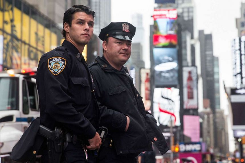New York police officers patrol in Times Square on Nov 19, 2015.