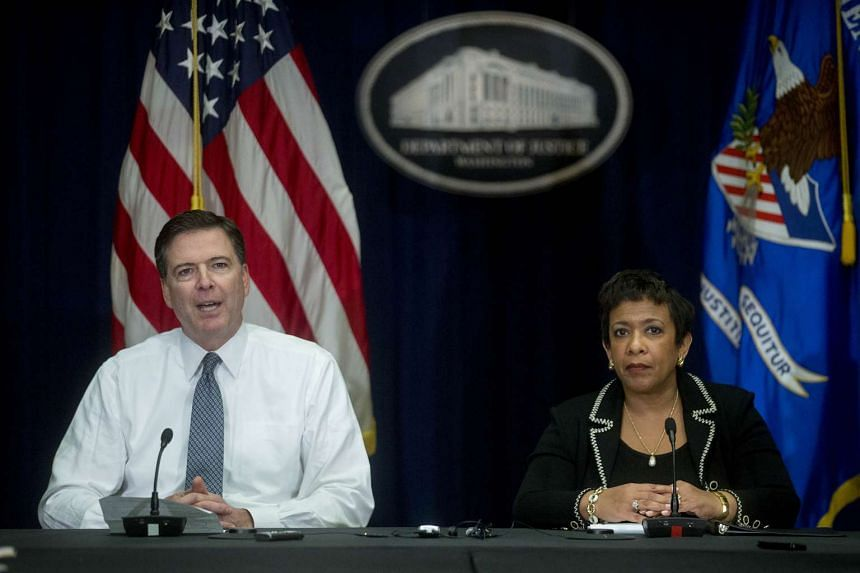 Mr James Comey, director of the Federal Bureau of Investigation (FBI), left, speaks during a news conference with Loretta Lynch, US attorney-general, at the Department of Justice in Washington, D.C., US, on Thursday, Nov 19, 2015. Mr Comey told repor