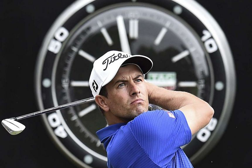 Australian golfer Adam Scott plays a shot during the second round of the Australian Masters Golf Tournament.