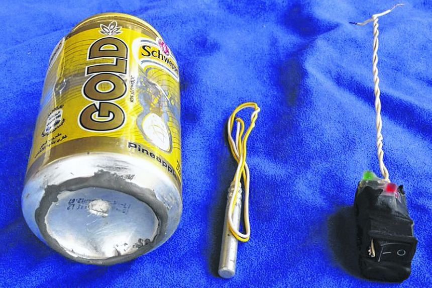 The Islamic State in Iraq and Syria's (ISIS) official magazine has carried a photo (above) of a soft drink can and what appeared to be a detonator and switch that it said were used to make an improvised bomb that brought down a Russian airliner over
