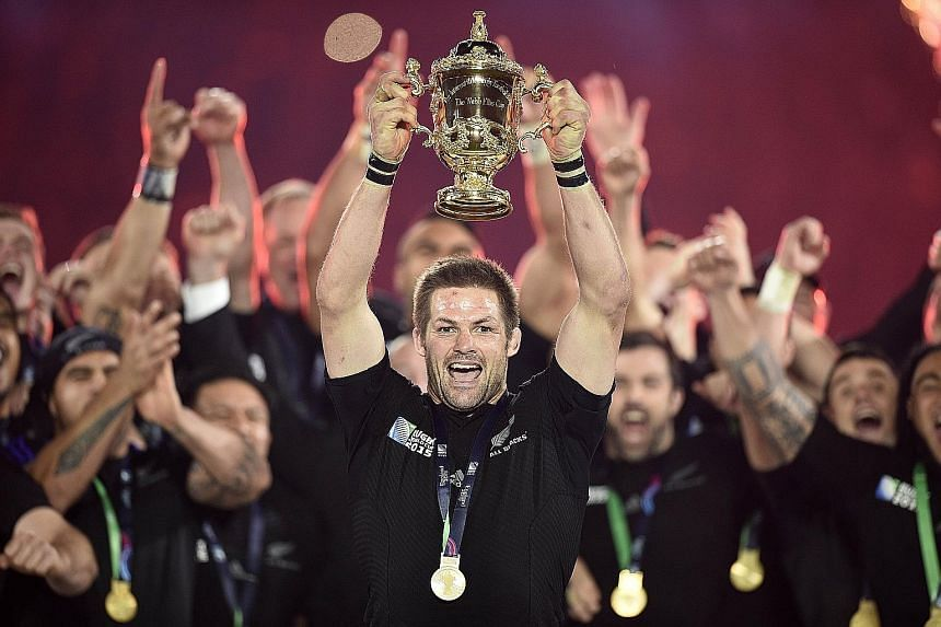All Blacks captain Richie McCaw holding up the Webb Ellis Cup after this year's Rugby World Cup final at Twickenham, London.