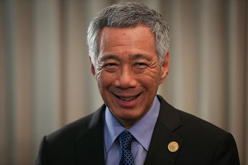 Prime Minister Lee Hsien Loong suggested that countries start opening up their service industry by focusing on sectors that will smoothen trade flow, such as telecommunications and logistics.