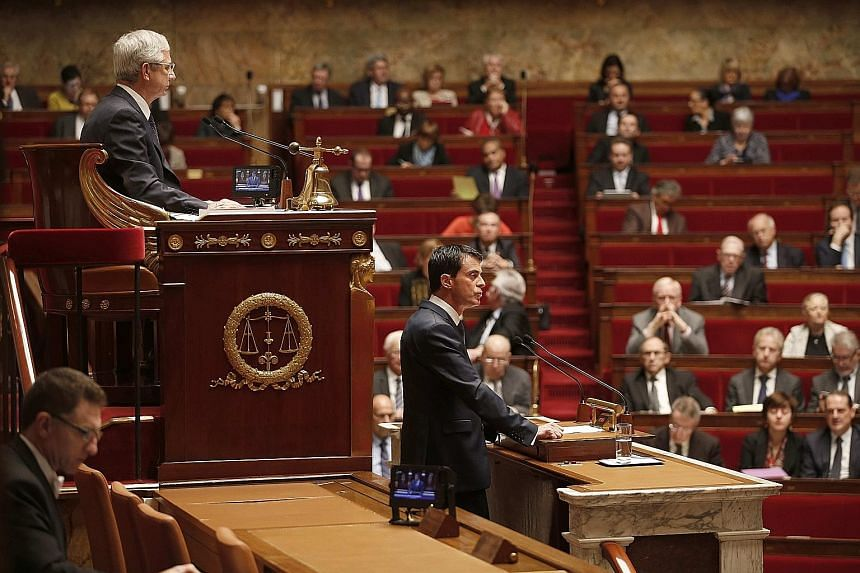 French Prime Minister Manuel Valls speaking during a debate to extend a state of emergency, at the National Assembly in Paris, France, yesterday, as French National Assembly president Claude Bartolone (top, left) listens.