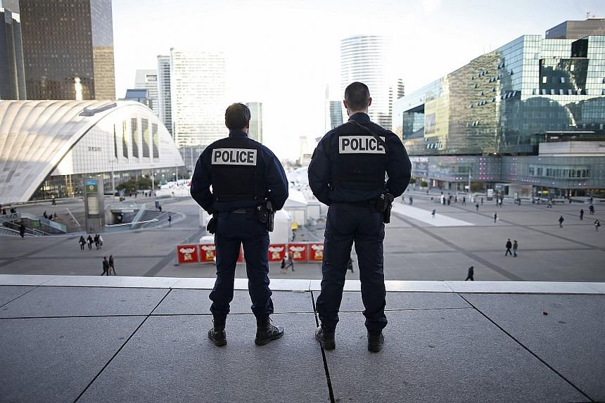 French police officers at the La Defense business district in Paris on Wednesday. One source told Reuters that a militant attack on La Defense was being prepared for yesterday. The district is home to some of France's biggest companies.