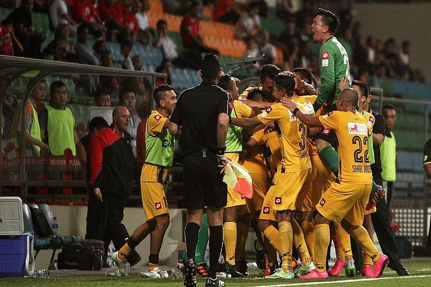 Brunei DPMM players celebrating their late winner against Courts Young Lions in their 2-1 win in September. They will be hoping to celebrate again tomorrow with a title-clinching performance.