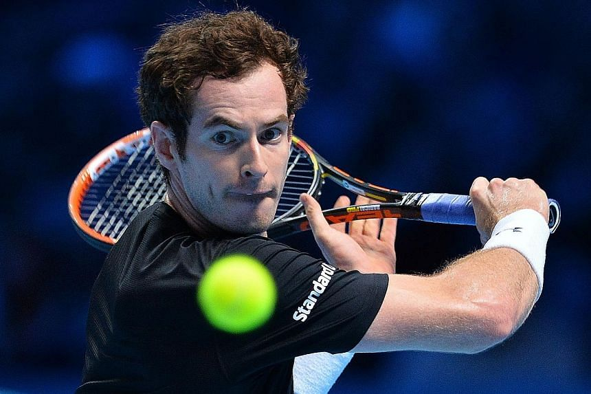 Andy Murray readying for a backhand return to Rafael Nadal during their ATP World Tour Finals round robin match. He plays Stan Wawrinka today, with the winner going through to the semi-finals with Rafael Nadal.