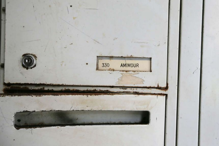 """Amimour"" is seen on a letterbox at the apartment building where Samy Amimour grew up in France."