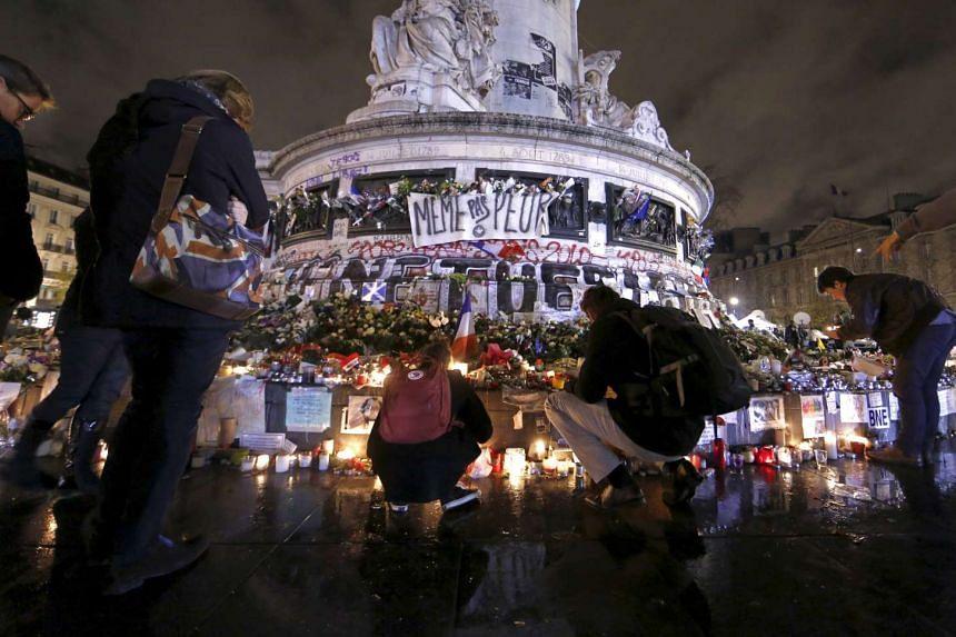 People paying tribute at the Place de la Republique in Paris on Nov 19, 2015.