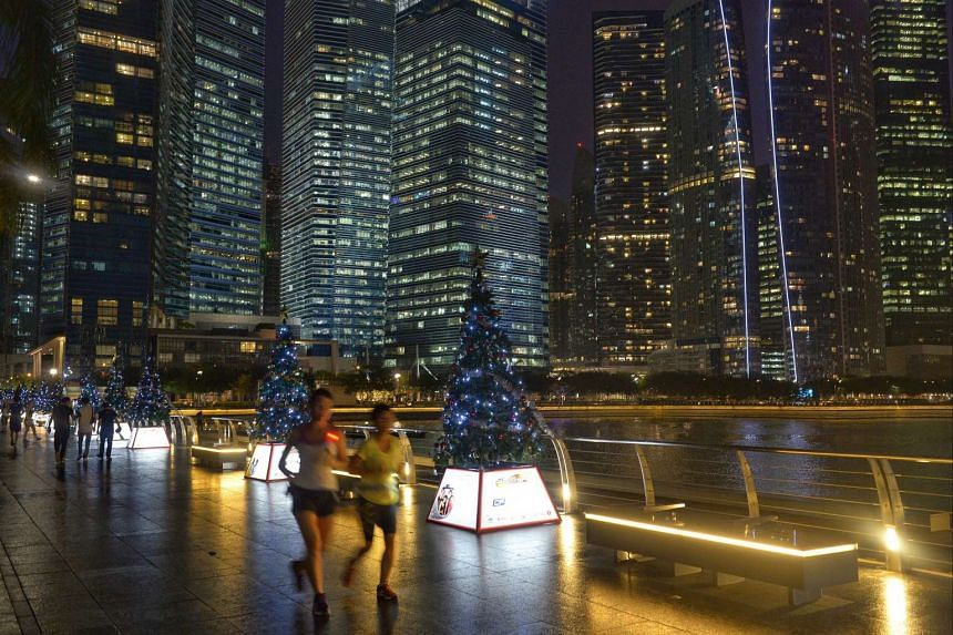 Some of the 30 ChariTrees featuring inspiring family stories lining the Marina Bay waterfront promenade.