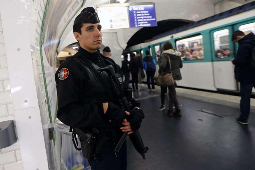 A French gendarme patrols in a railway station in Paris on Nov 19, 2015.