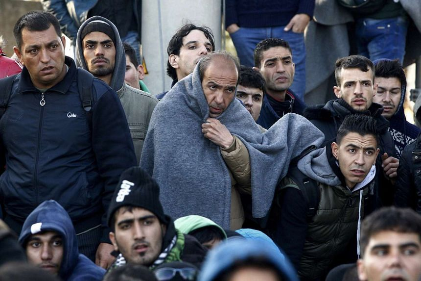 Migrants wait next to Greece's border with Macedonia on Nov 19, 2015.