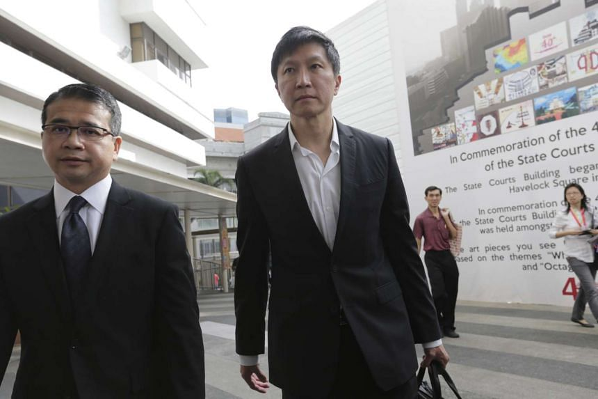 Kong Hee (right) arriving at the State Courts with his lawyer on Nov 20.