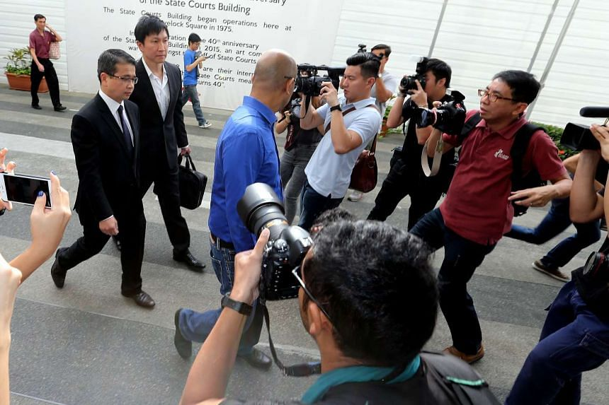 Kong Hee (second from left) and his lawyer Edwin Tong arriving at the State Courts on Nov 20, 2015.