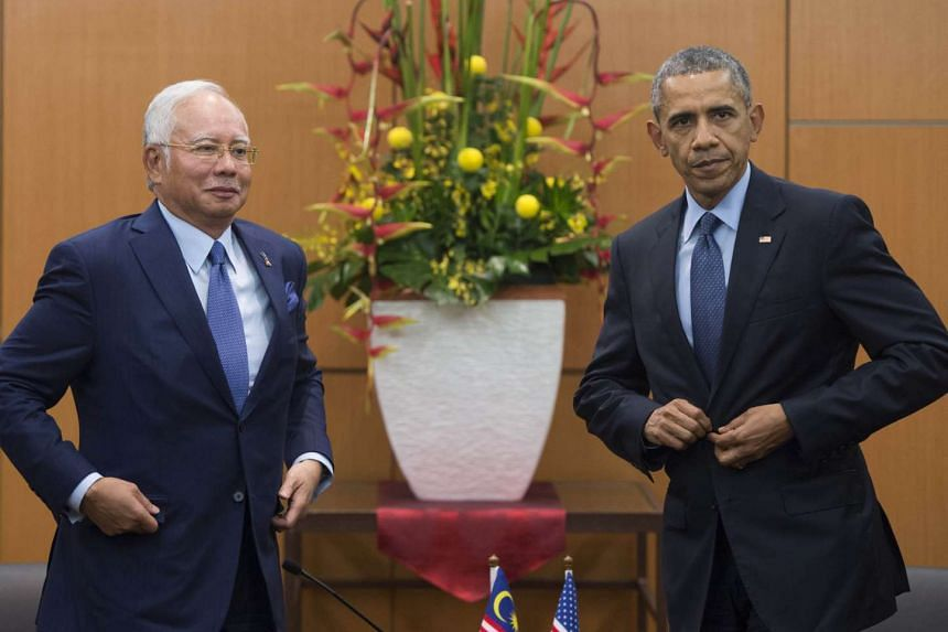 Malaysian Prime Minister Najib Razak (Left) and US President Barack Obama after a meeting at the Kuala Lumpur Convention Center.