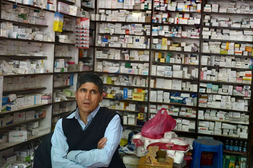 A Nepalese pharmacist waiting for customers at his pharmacy in Kathmandu on Nov 19.