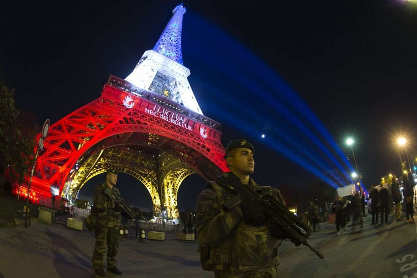 A French soldier in Paris in front of the Eiffel Tower on Nov 18, 2015.