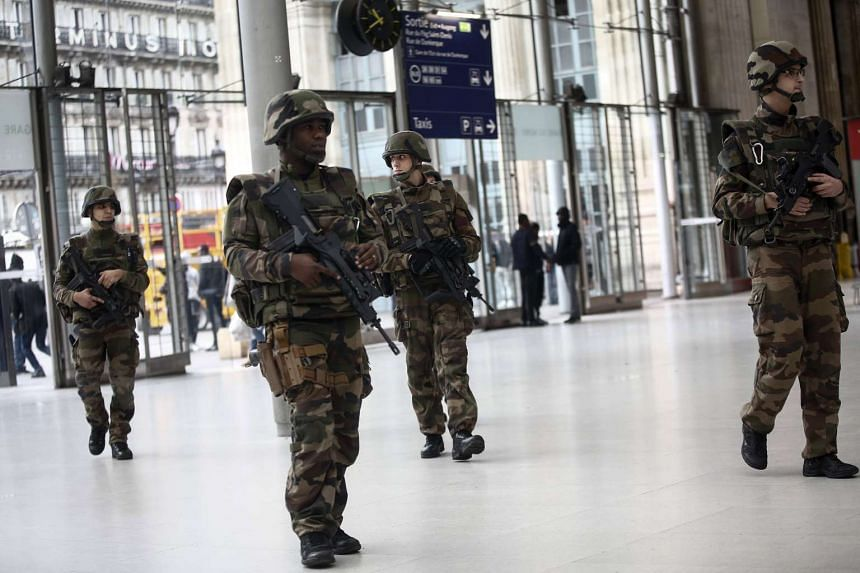Members of the French army patrol at the Gare du Nord train station in Paris on Nov 14, 2015.