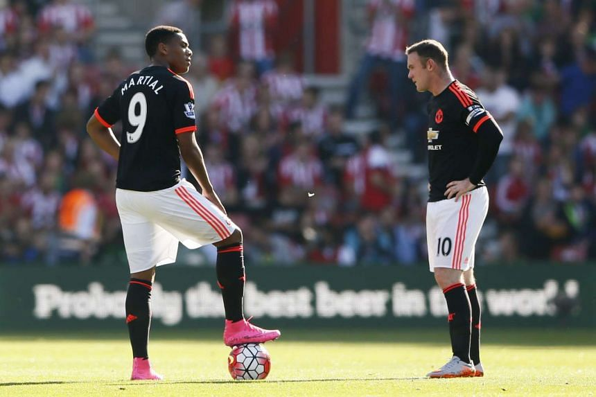 Wayne Rooney (right) and Anthony Martial will both be absent at Vicarage Road.