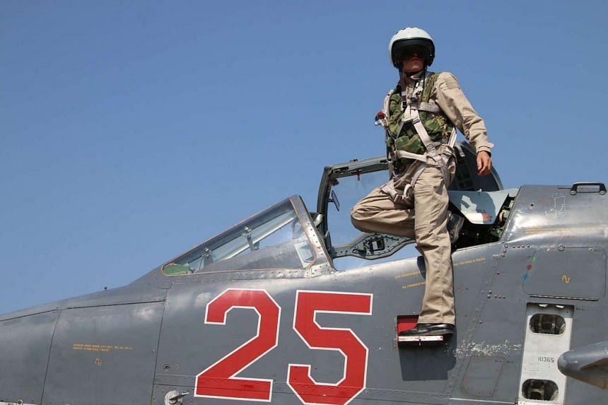 A Russian army pilot leaving the cockpit of a Russian Sukhoi Su-25 ground attack aircraft.
