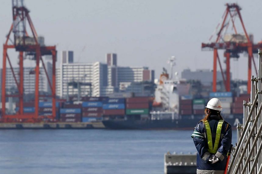 A port in Tokyo. The world's third-largest economy slipped into its second recession in two years and monthly exports fell. Talk has it that the BoJ will be forced to expand its $923 billion annual asset-buying scheme.