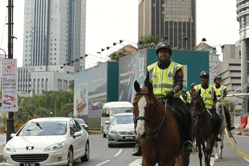 Malaysian police officers on patrol yesterday near the Kuala Lumpur Convention Centre, the venue for the 27th Asean Summit.