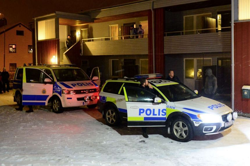 Swedish police outside a house used as a temporary shelter for asylum seekers in Boliden, Sweden, on Nov 19.