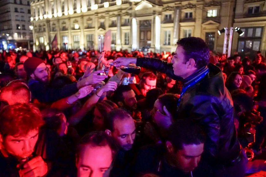 People drink wine during the official launch of the 2015 Beaujolais Nouveau in Lyon, France.