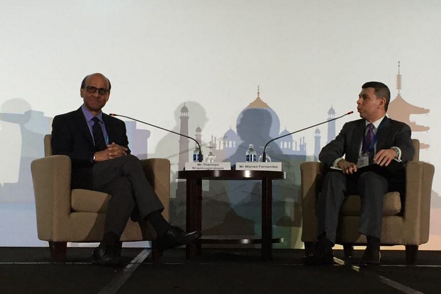 DPM Tharman Shanmugaratnam (left) and ST editor Warren Fernandez.