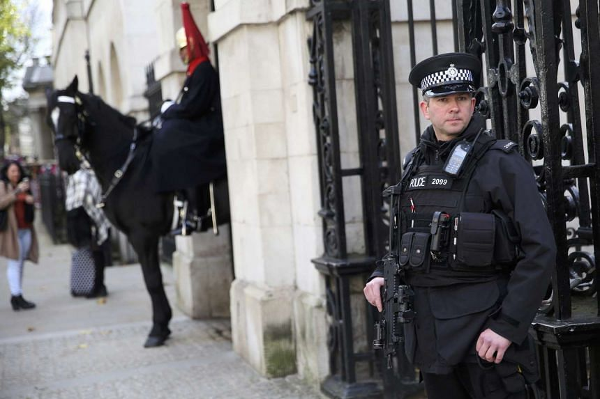 An armed police officer standing outside Horseguards on Whitehall in London on Nov 18.