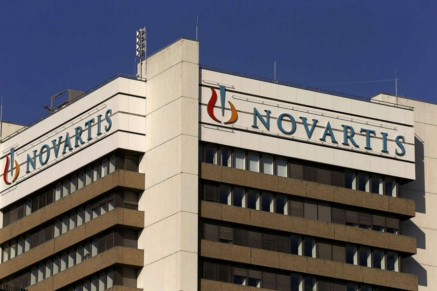 A sign of Swiss pharmaceutical giant Novartis is seen on the top of a building at the company's campus on Oct 27, 2015 in Basel.