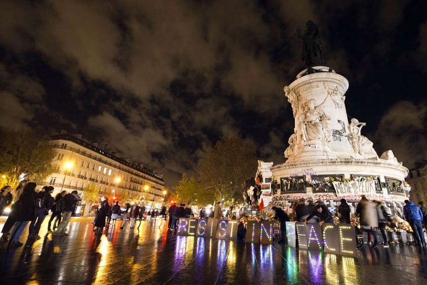 People gathering at the Place de la Republique square in Paris on Nov 17 to pay tribute to victims of the Nov 13 attacks.