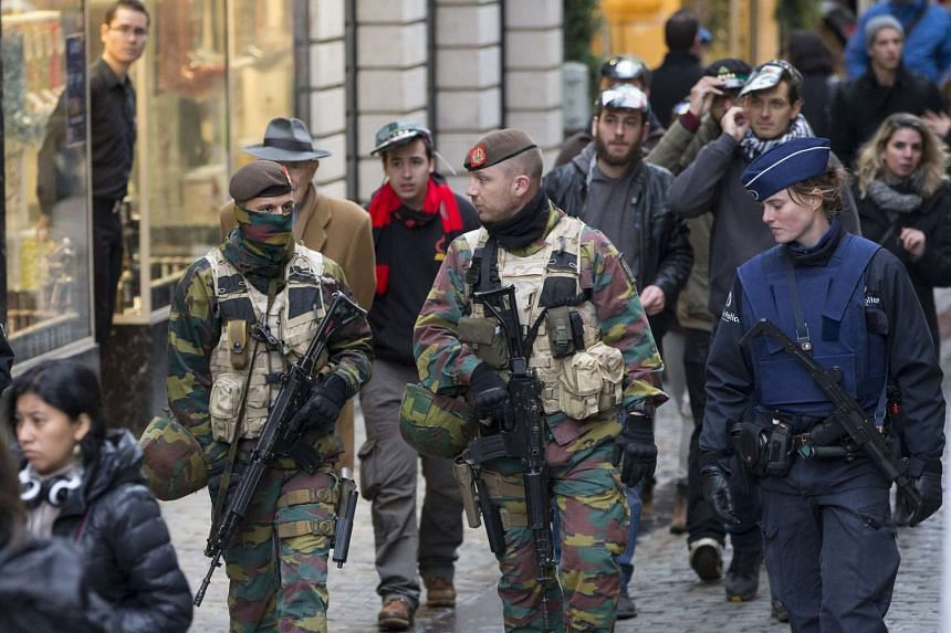 Belgian soldiers and police patrolling Brussels Grand Place after security was tightened on Nov 20.