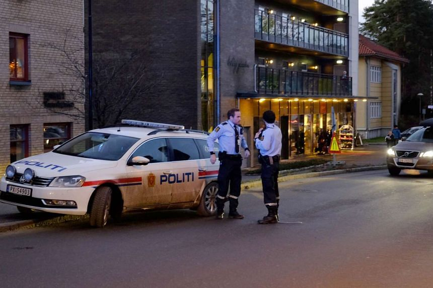 Police work at the scene where two police officers were stabbed in Vennesla, some 350 km south west of Oslo on Nov 20, 2015.