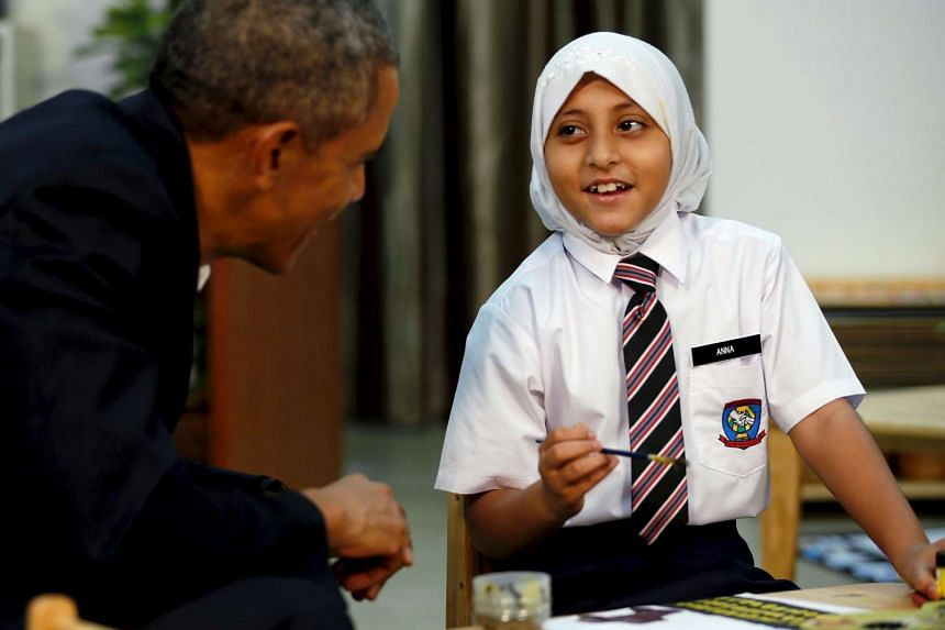 US President Barack Obama (left) greets students while on a tour of the Dignity for Children Foundation in Kuala Lumpur, Malaysia on Nov 21, 2015.