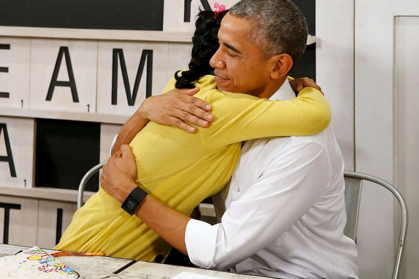 US President Barack Obama (right) gets a thank-you hug from a 16-year old refugee, a victim of human trafficking who will soon be resettled in the US on Nov 21, 2015.