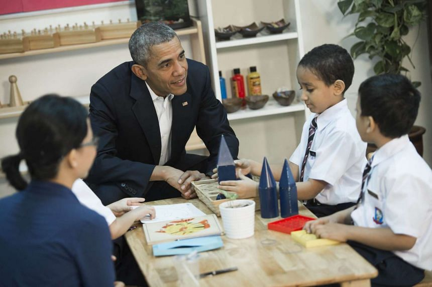 US President Barack Obama (centre) speaks with children as he tours the Dignity for Children Foundation in Kuala Lumpur on Nov 21, 2015.