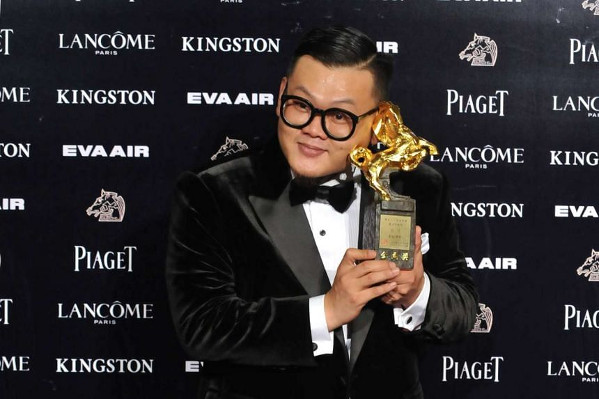 Hong Kong actor Michael Ning poses with his trophy after winning the Best Supporting Actor award during the 52nd Golden Horse Film Awards.