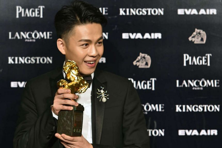 Taiwanese actor Lee Hong-chi displays a trophy after winning the Best New Performer during the 52nd Golden Horse Film Awards.