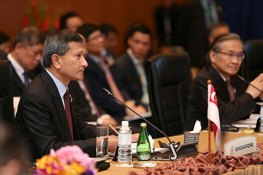 "Dr Vivian Balakrishnan (left) at the Asean Summit in Kuala Lumpur yesterday. An Asean-China FTA upgrade ""will enhance opportunities for trade, investments and for people to people engagement"", he said."