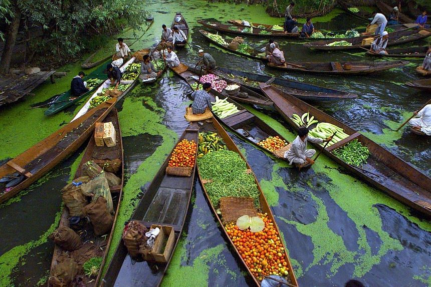 Vegetable sellers at a floating market on Dal Lake in Srinagar, the summer capital of Jammu and Kashmir state. India's participation in Apec would help open its giant domestic market to investment for decades to come.