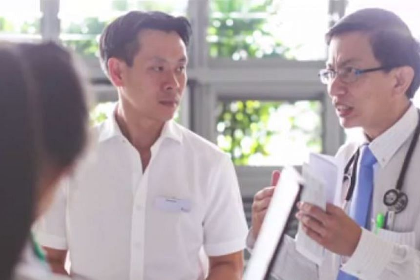 Mr Ng accompanying a doctor on his daily rounds.