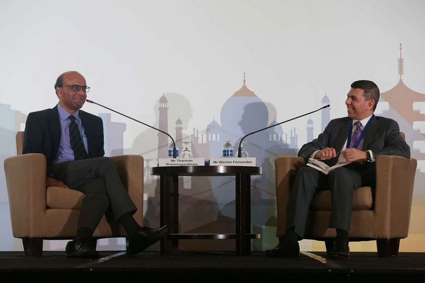 DPM Tharman Shanmugaratnam (left) and ST editor Warren Fernandez during a dialogue session at The Straits Times Global Outlook Forum 2015 on Nov 20, 2015.