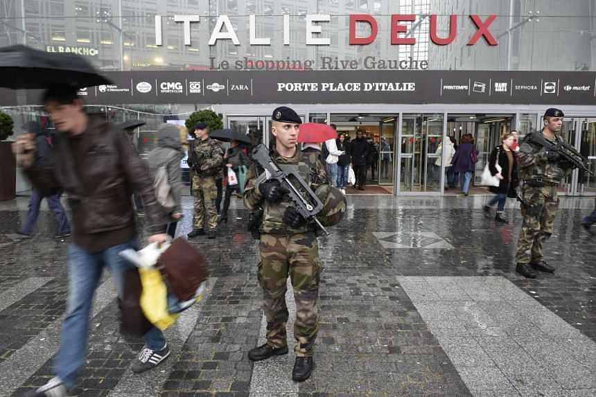 French soldiers patrol outside the Italie Deux shopping centre in Paris on Nov 20, 2015.